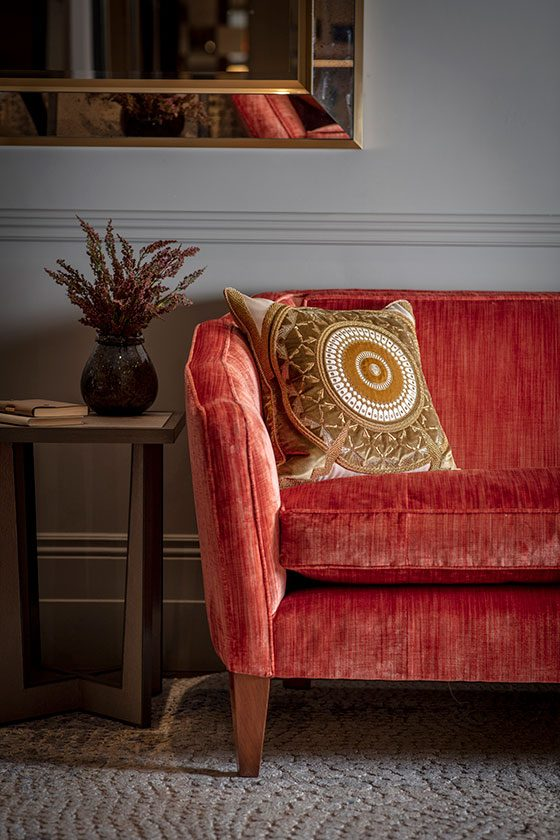 Josephine sofa in Como Pompeiian red detail with Ettore cushion - beaumont-&-fletcher